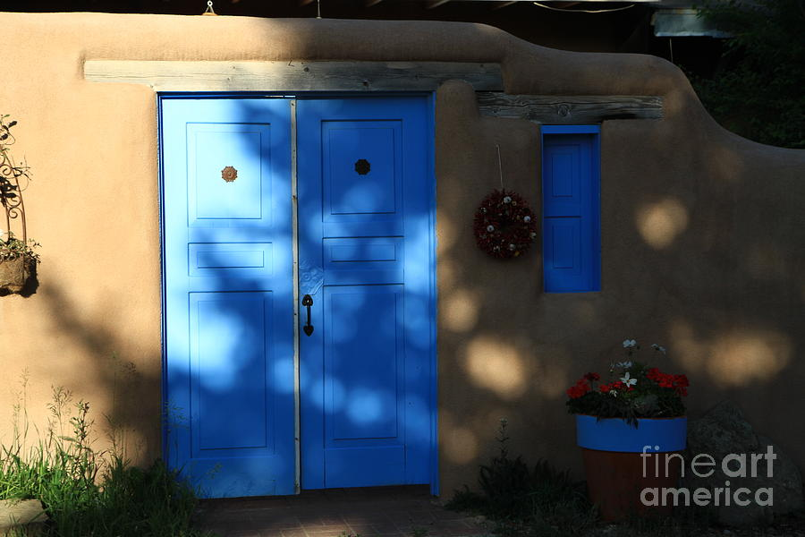 Adobe And Blue Photograph