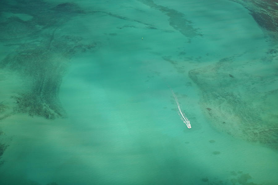 Aerial Of Turquoise Waters With Passing Photograph by Merten Snijders