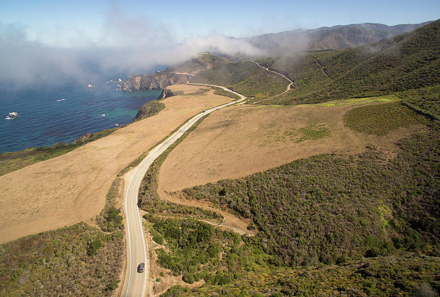Nature Photograph - Aerial View Of Fog Above Coastline by Matt Andrew