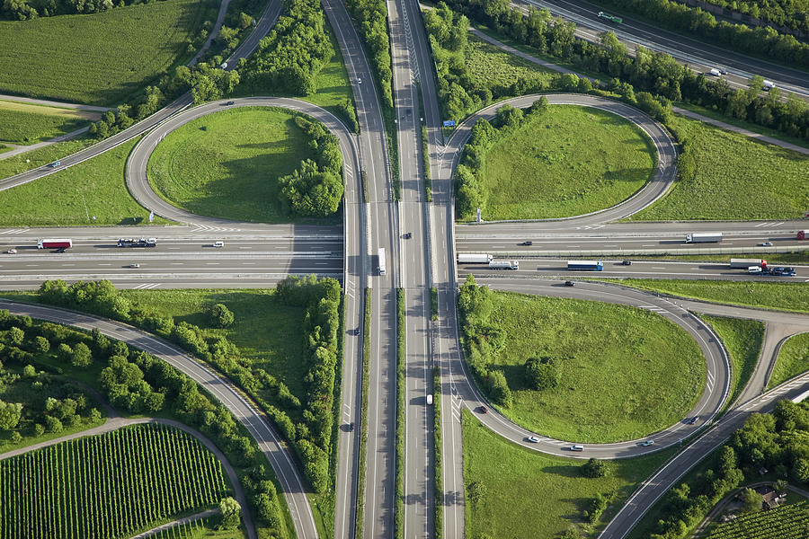 Aerial View Of Highway Junction In Photograph by Grafissimo