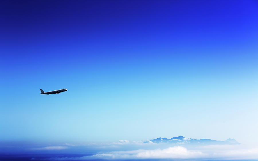 Outdoors Photograph - Aeroplane Flying In A Clear Blue Sky by Wladimir Bulgar