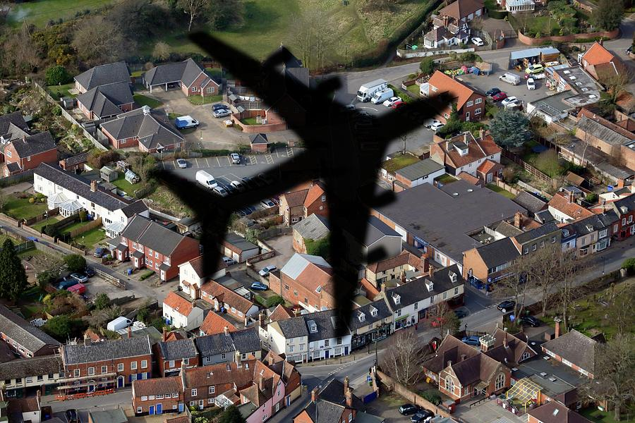Nobody Photograph - Aeroplane Shadow Over Houses by Victor De Schwanberg