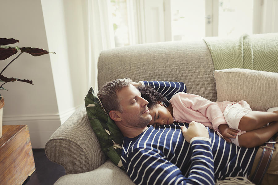 Affectionate, Serene Multi-ethnic Father And Daughter Napping On Sofa Photograph by Caiaimage/Paul Bradbury