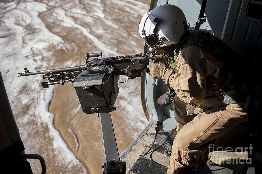 Afghan Air Force Gunner Fires An M-240 Photograph