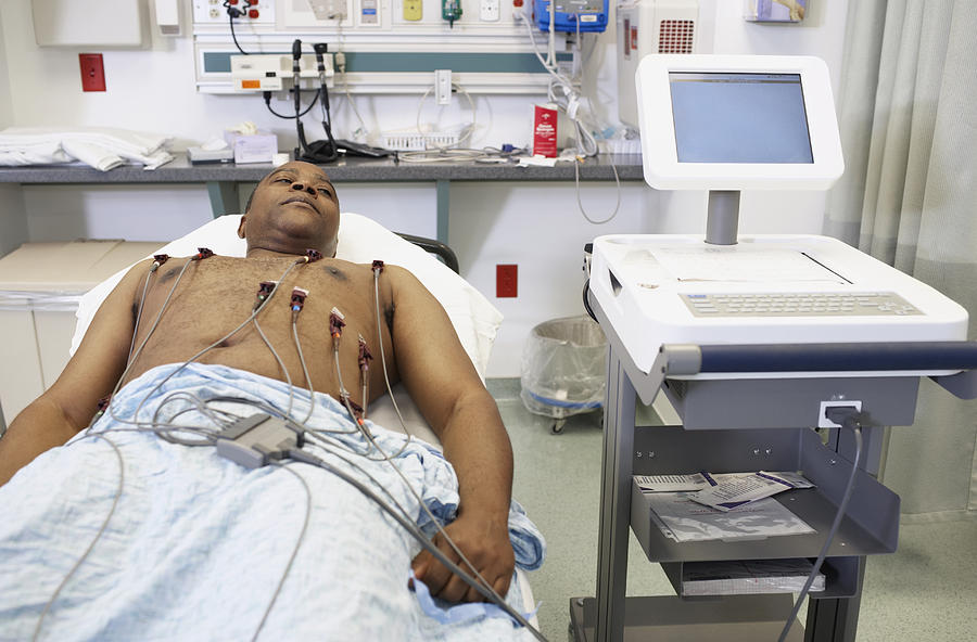African American man in hospital bed Photograph by ER Productions Limited