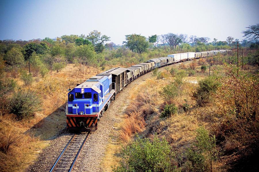 African Cargo Train Between Zimbabwe Photograph by Beyondimages