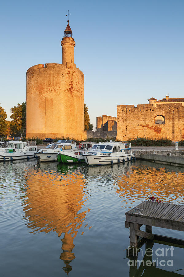 Canal Photograph - Aigues-mortes  Languedoc-roussillon France Constance Tower by Colin and Linda McKie