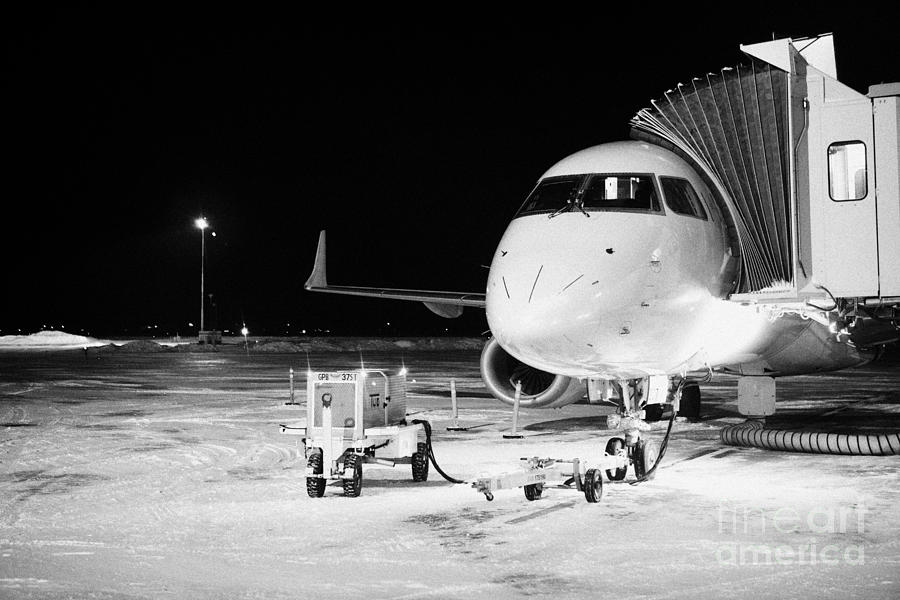 Air Canada Embraer E Jet On Stand At Frozen Snow Covered
