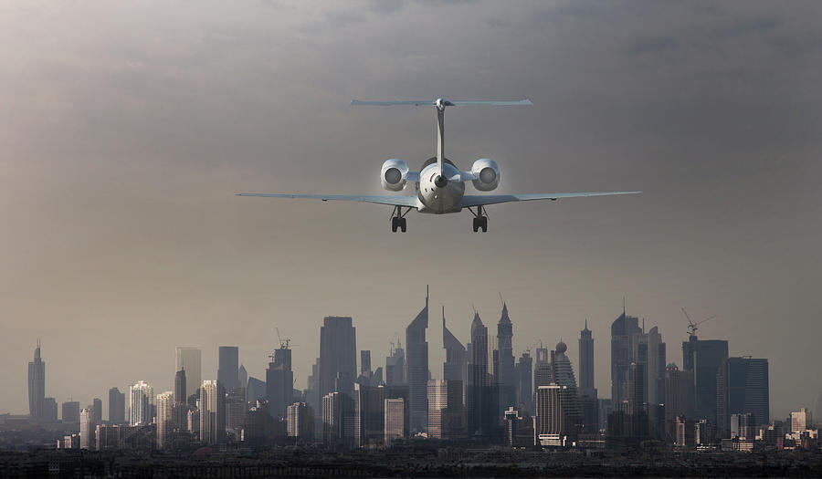 Airplane Landing In A Futuristic City Photograph by Buena Vista Images