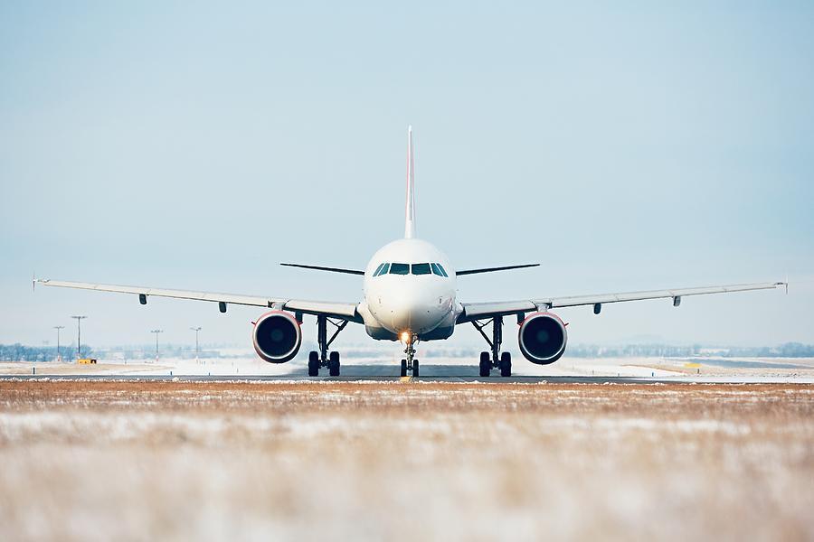 Airplane On Airport Runway Against Clear Blue Sky Photograph by Jaromir Chalabala / EyeEm