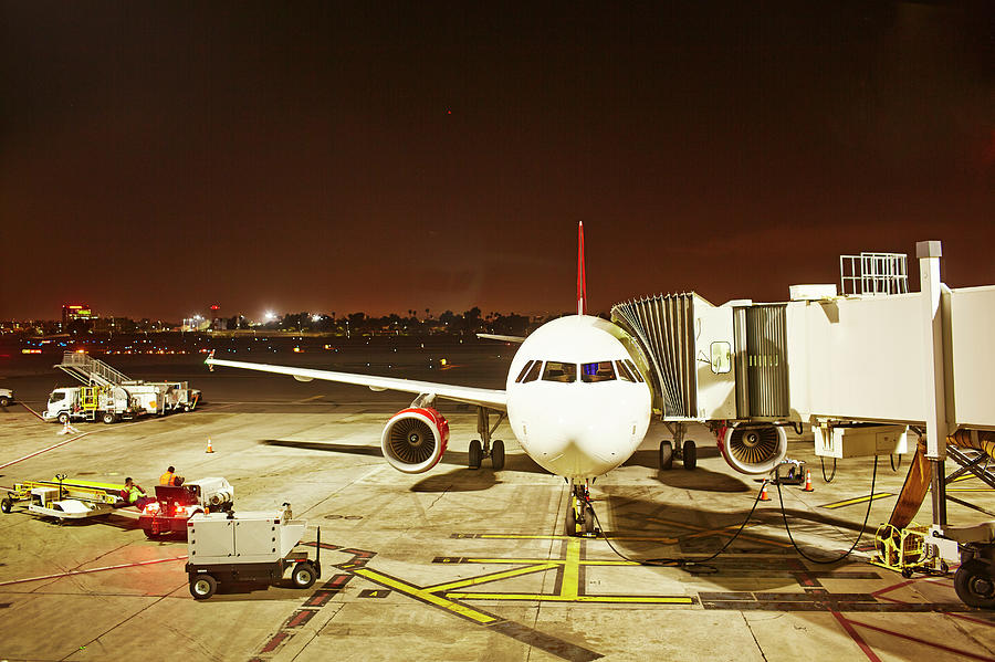 Airplane Parked At Jetway Photograph by Ballyscanlon