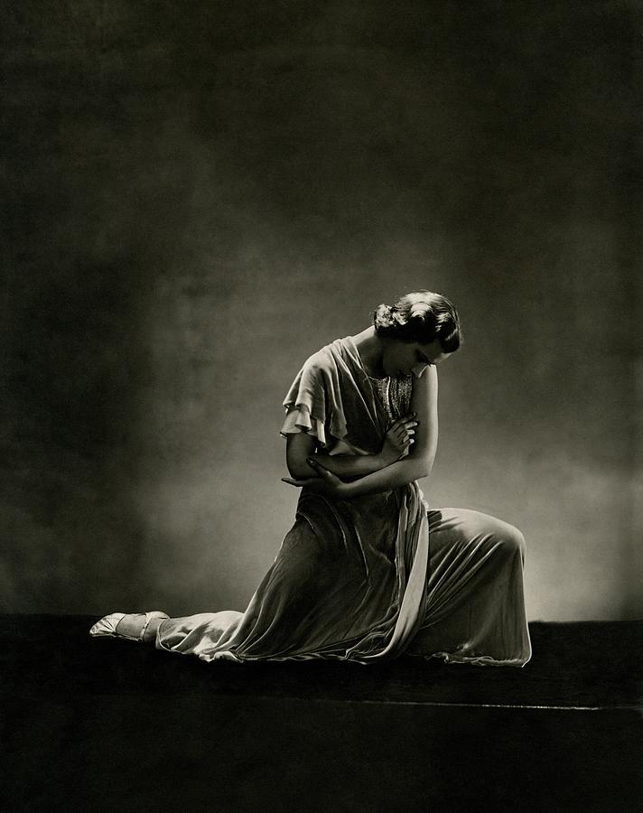 Alanova Kneeling In A Dress Photograph by George Hoyningen-Huene