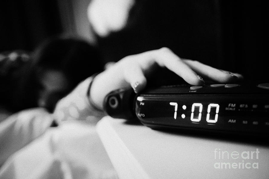 Alarm Photograph   Alarm Clock Early Morning With Early Twenties Woman  Turning Off Alarm Lying In