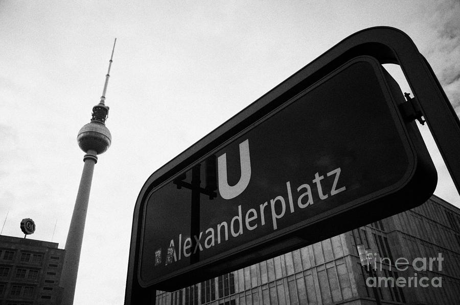 Berlin Photograph - Alexanderplatz U-bahn Station Entrance Sign And Tv Tower Berliner Fernsehturm Berlin Germany by Joe Fox