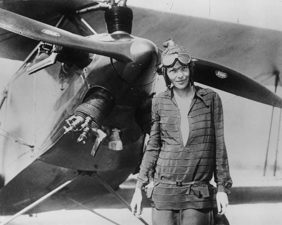 Ameila Earhart With Airplane Photograph by Getty Images