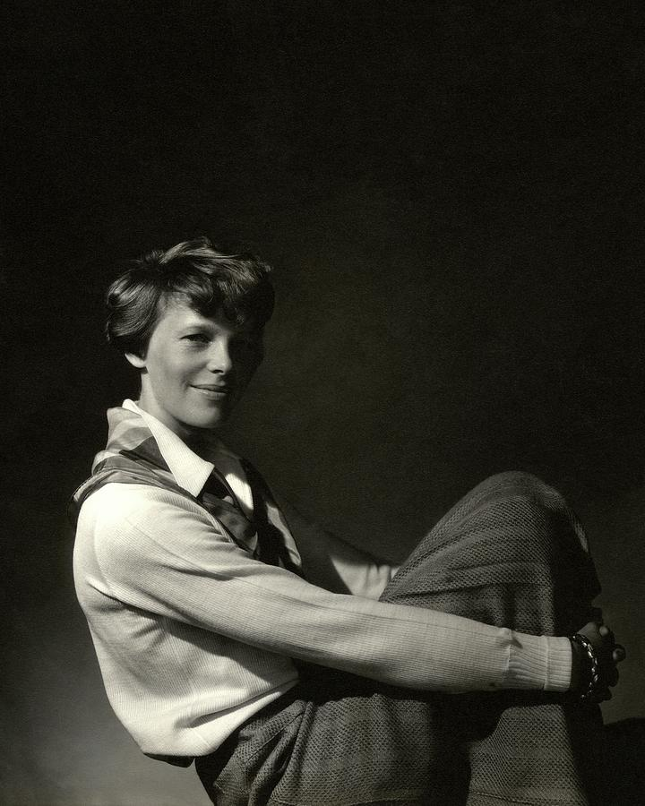 Amelia Earhart Hugging Her Knees Photograph by Edward Steichen
