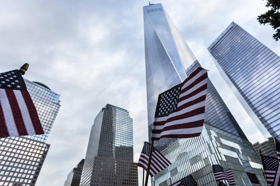 American flag in front of the One World World trade Center in New York city Photograph by @ Didier Marti