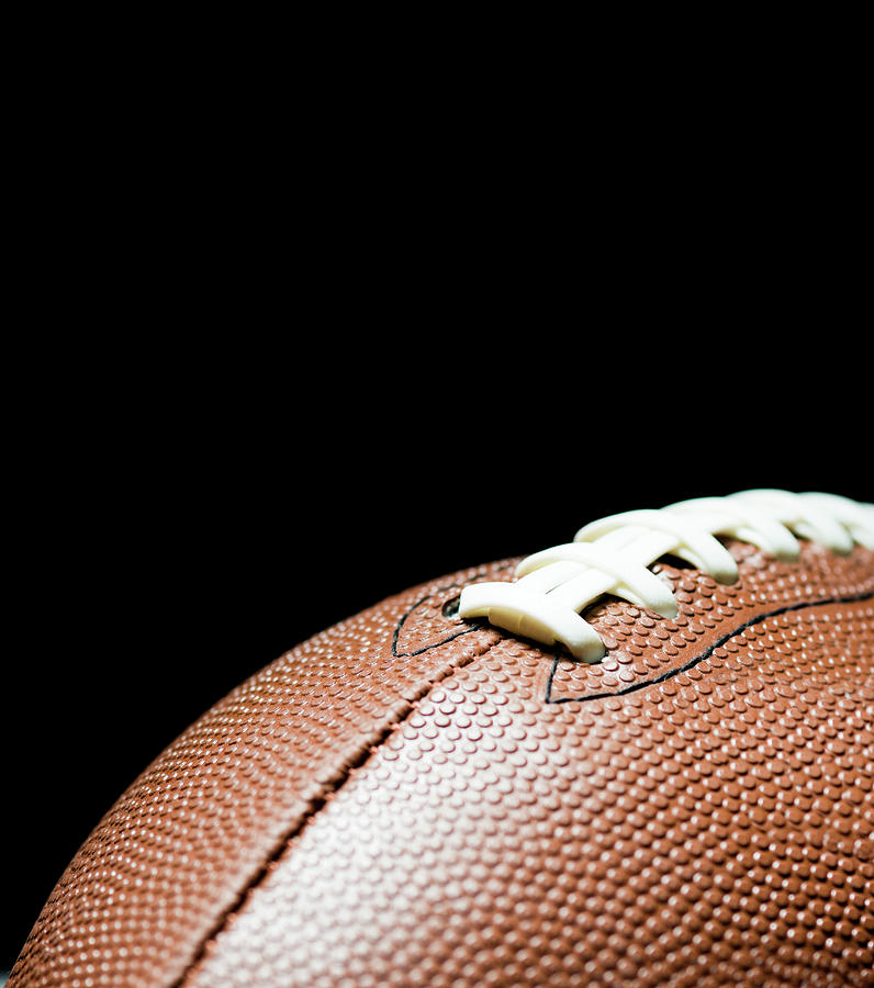 American Football On Black Background Photograph by By nicholas