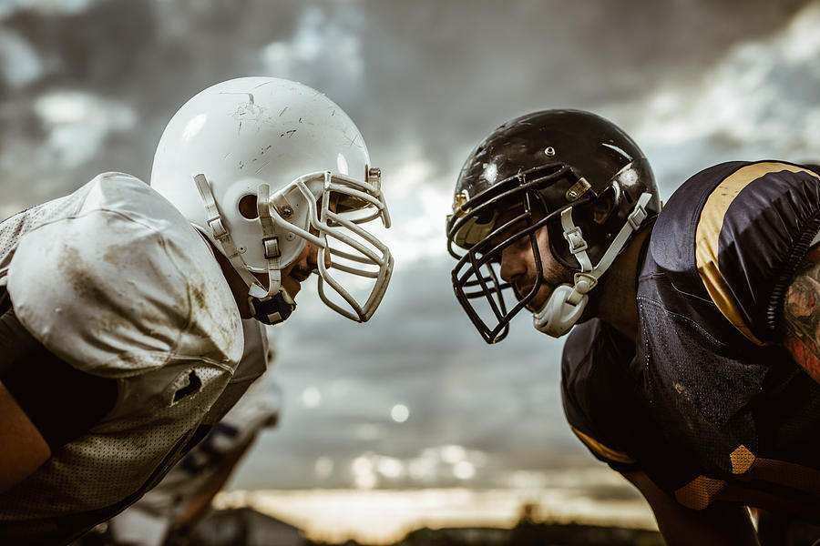 American football players confronting before the beginning of a match. Photograph by Skynesher