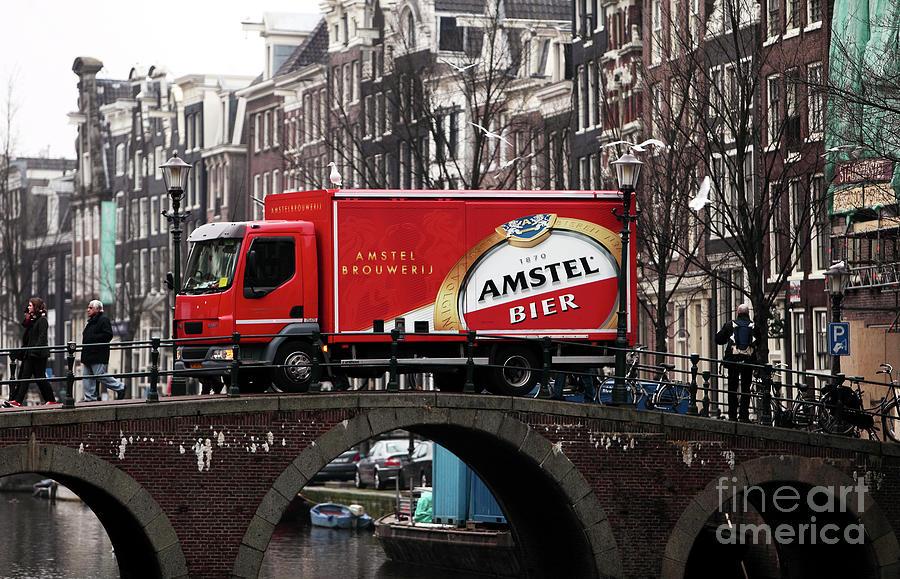 Europe Photograph - Amstel Bier by John Rizzuto