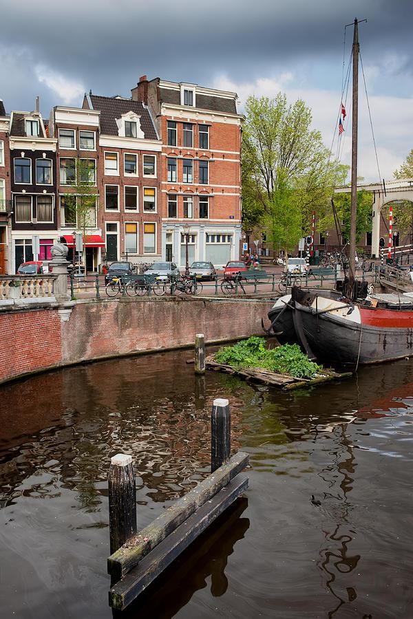 Amsterdam Photograph - Amstel River Waterfront In Amsterdam by Artur Bogacki