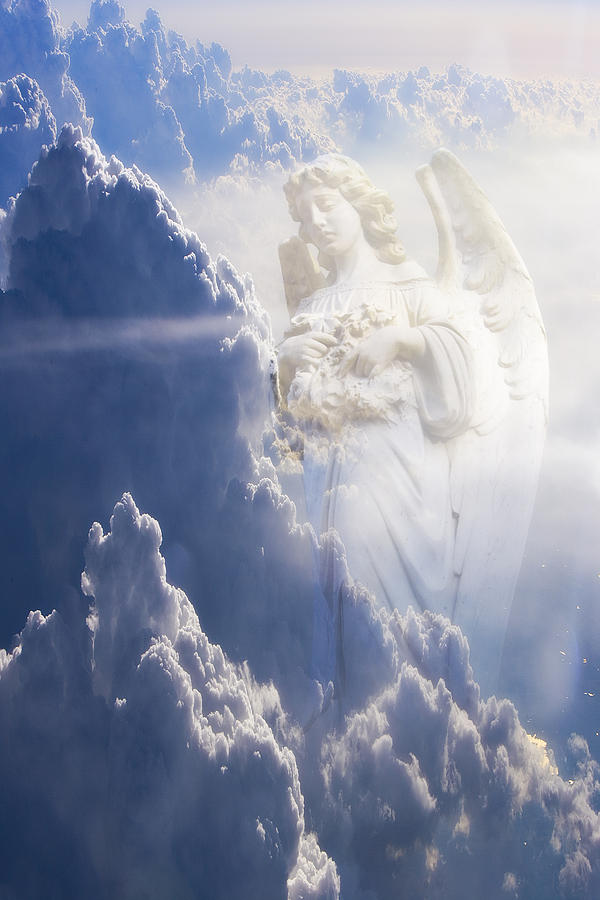 Angel Photograph - An Angel In The Clouds by Jim Zuckerman