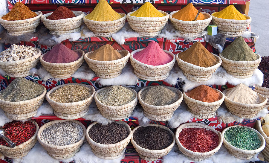 An Egyptian spice market with baskets full of spice Photograph by Onfilm