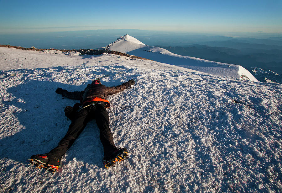 Achievement Photograph - An Exhausted Climber Lies On The Summit by Michael Hanson