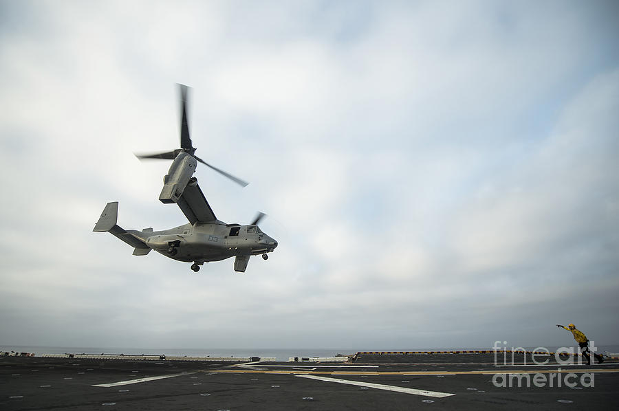 Horizontal Photograph - An Mv-22 Osprey Is Guided Onto by Stocktrek Images