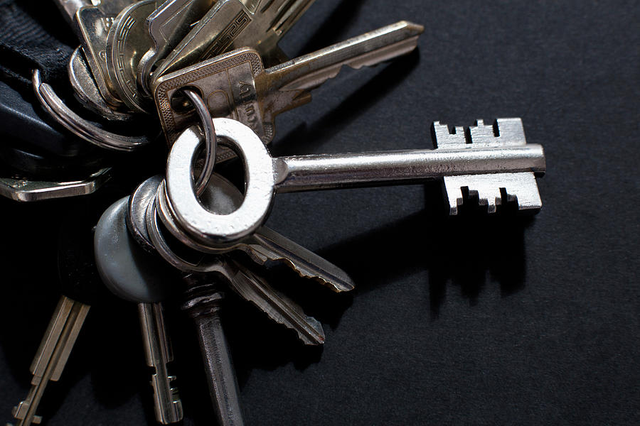 An Odd Shaped Old-fashioned Key Photograph by Larry Washburn