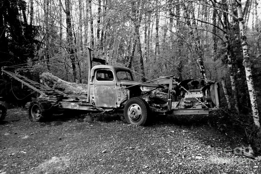An Old Logging Boom Truck In Black And White Photograph
