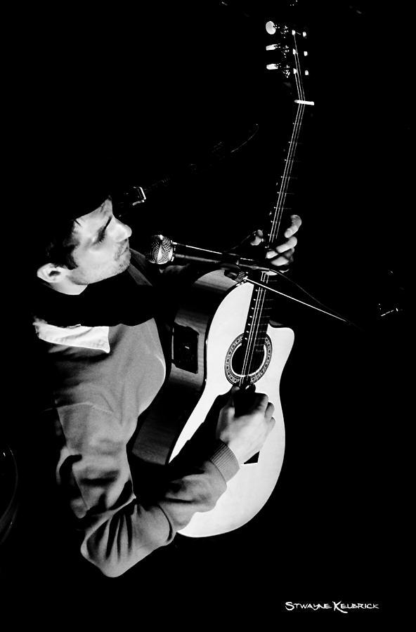 Guitar Photograph - An unreachable guitarist by Stwayne Keubrick