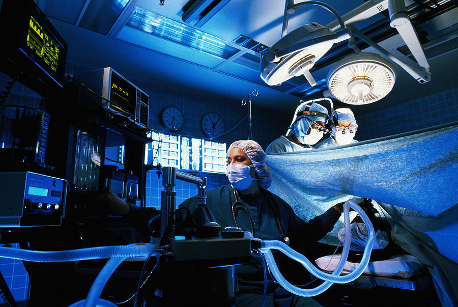 Anaesthetist Monitoring Patient During Micro Surgery by Charles Thatcher