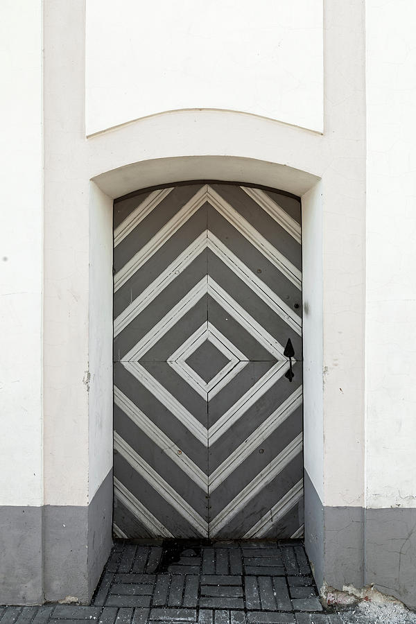 Ancient Wooden Striped Door In Stone Photograph by Eugenesergeev
