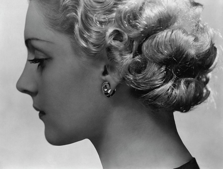 Andree Lorain Wearing Rene Boivin Ear Clips Photograph by George Hoyningen-Huene