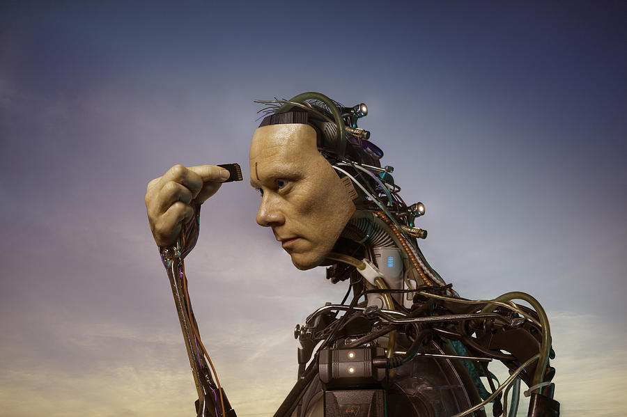 Android Robot Replacing Memory Card Photograph by Peter Sherrard
