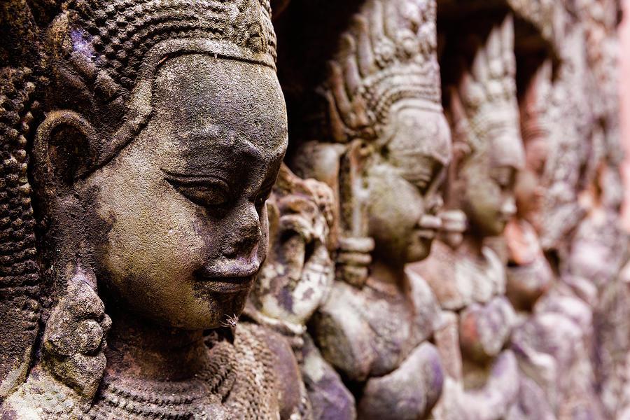 Angkor Wat Temple Wall Faces Detail Photograph by Daniel Osterkamp