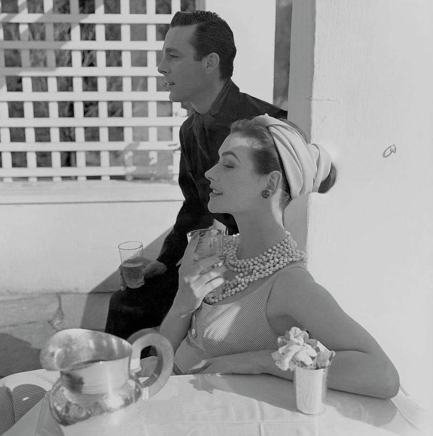 Anne Gunning Parker Sitting With A Man Photograph by Horst P. Horst
