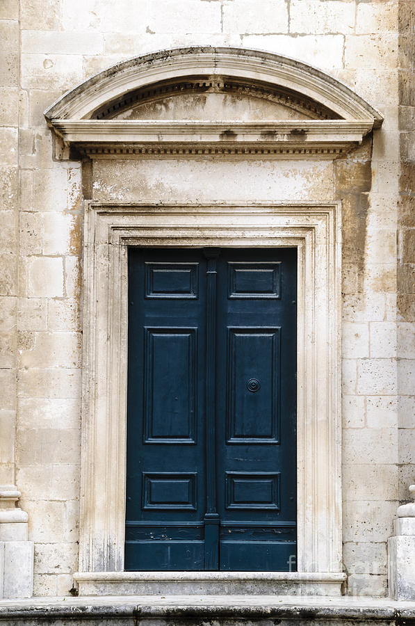 antique blue door photograph by oscar gutierrez