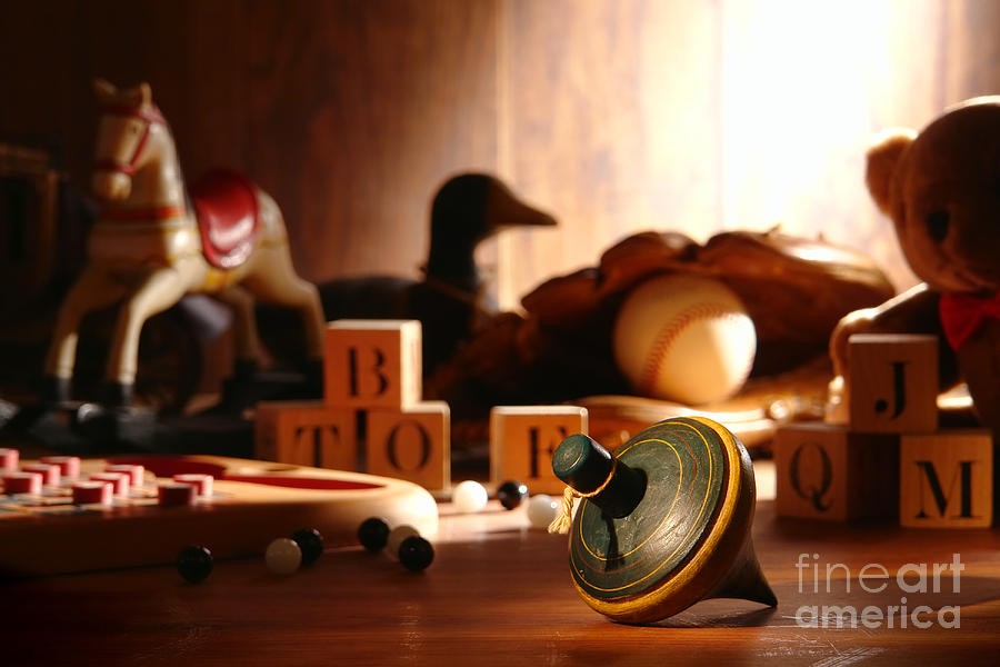 Spinning Photograph - Antique Spinning Top by Olivier Le Queinec