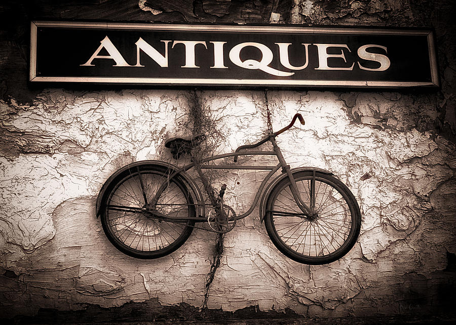 Abstract Photograph - Antiques And The Old Bike by Bob Orsillo