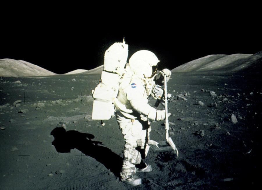 Apollo 17 Photograph - Apollo 17 Astronaut Collecting Lunar Rock Samples by Nasa/science Photo Library