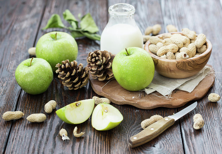 Apples And Peanuts For Breakfast Photograph by Julia Khusainova