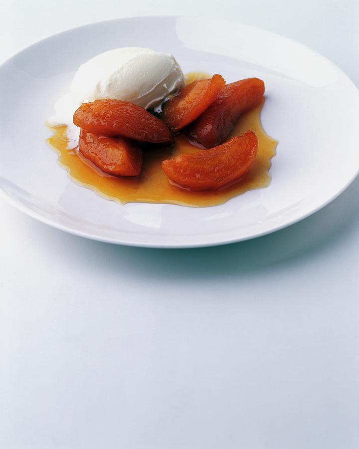 Apricots Served With Vanilla Ice Cream Photograph by Romulo Yanes