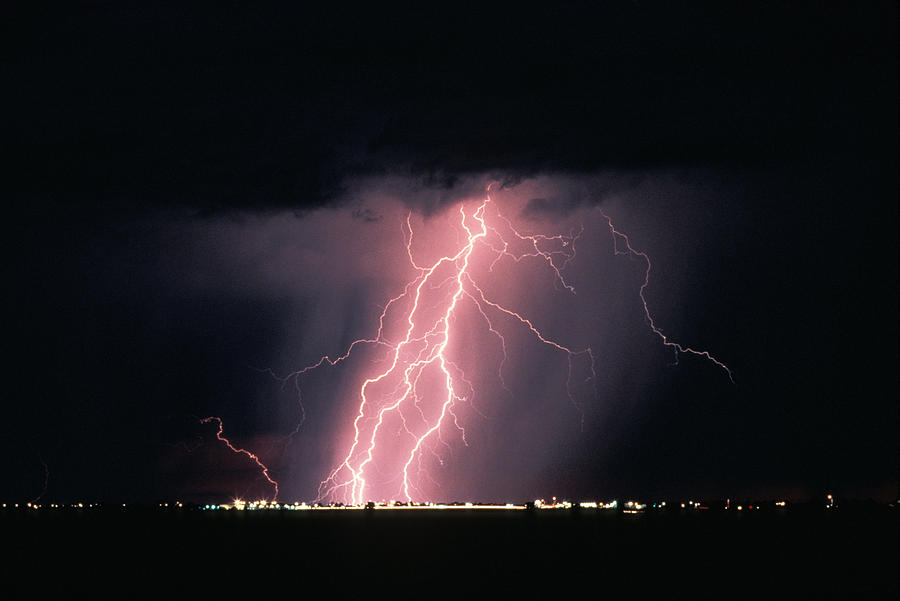 Ominous; Arizona; Storm Cloud; Overcast; Dramatic Sky; Storm; Landscape; Power In Nature; Travel; Pink; No People; Horizontal; Outdoors; Night; Lightning Photograph - Arizona  Lightning Over City Lights by Anonymous