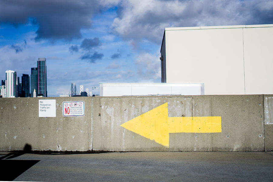 Arrow On Wall Against Sky Photograph by Jesse Coleman / EyeEm