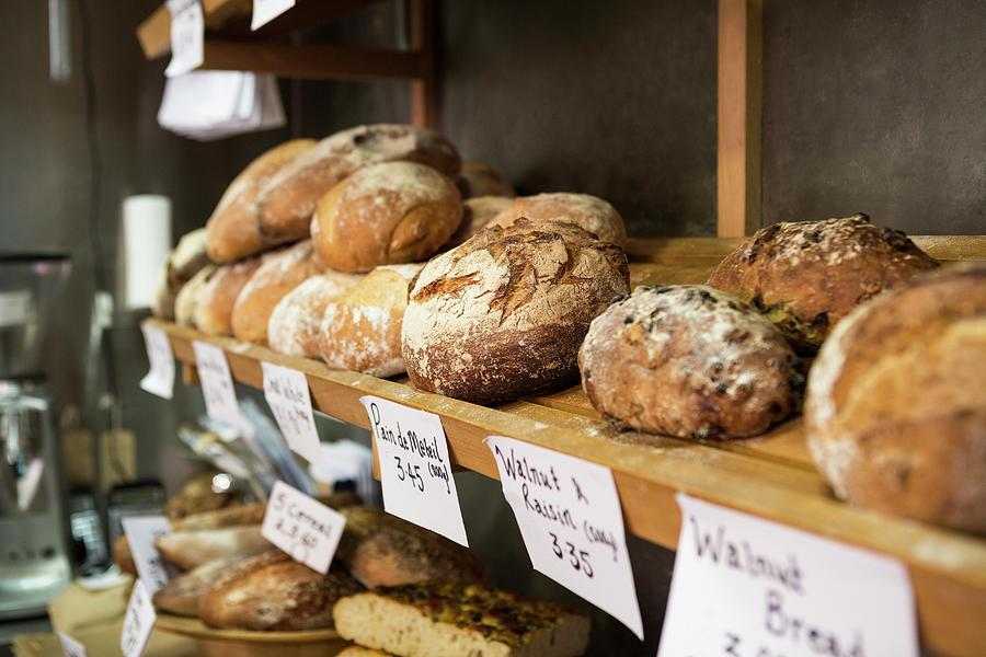Artisan Bread On Shelves In Bakery Photograph by Betsie Van Der Meer