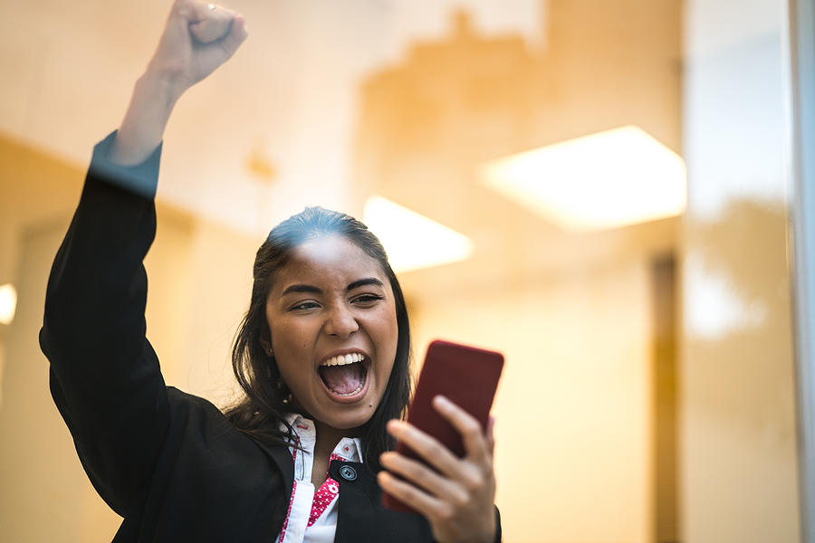 Asian Business Woman Celebrating With Mobile Phone Photograph by FG Trade