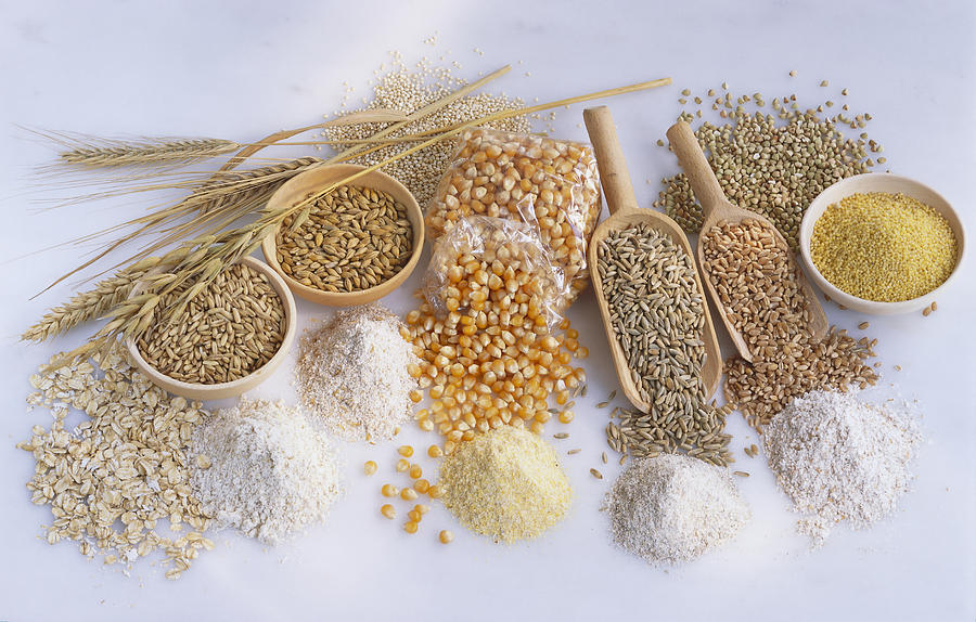 Assorted Cereals, Flour And Grains In Piles, Bowls And Scoops Photograph by Maximilian Stock Ltd.