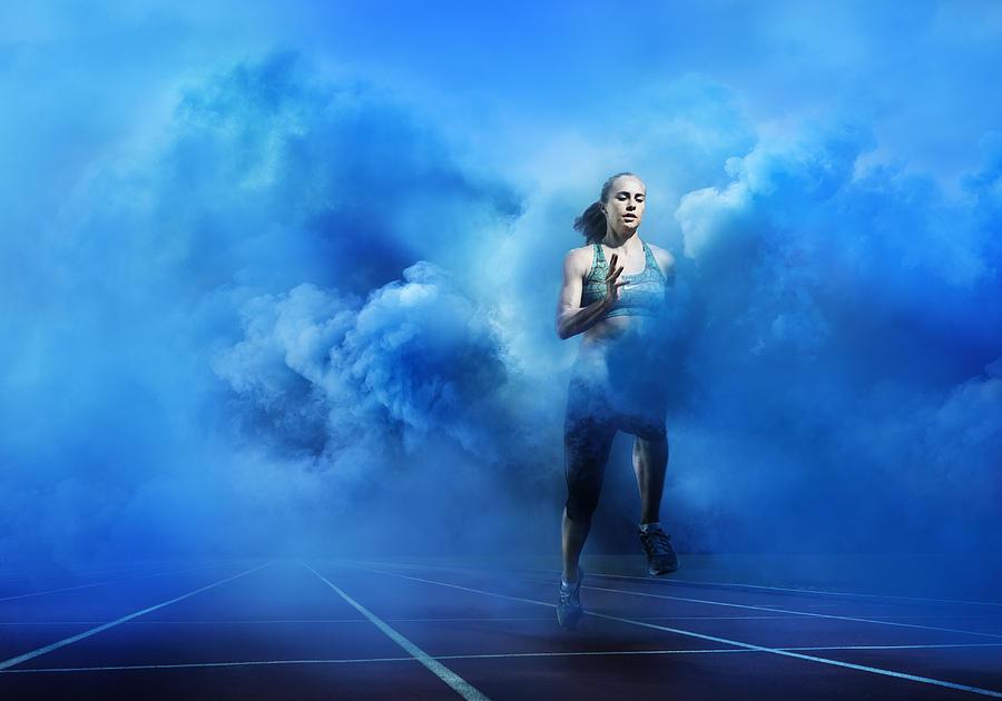Athlete Running Through Blue Smoke Photograph by Henrik Sorensen